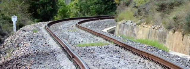 railroad tracks bending around a curve